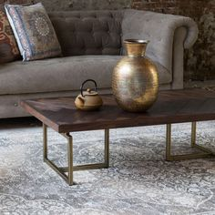 Dutchbone+Class+Coffee+Table+-+Rectangular+acacia+wood+veneer+coffee+table+with+herringbone+pattern+and+antique+brass+base.  Add+a+touch+of+restrained+glamour+to+your+lounge+furniture+arrangement+with+the+Dutchbone+Class+Coffee+Table.  Exuding+a+luxe+aesthetic+with+elegant+and+timeless+proportions,+this+unique+coffee+table+is+inspired+by+the+revival+of+herringbone+flooring…