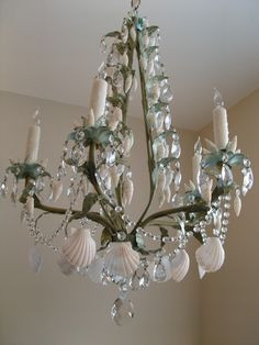 SEA MIST by Marjorie Stafford Design Italian Vintage Chandelier embellished with hand painted custom colors, scallop shells, Vertagos, Crystal Bead Swags, Almond Drops and large almond drop at base. Beach Chandelier, Vintage Chandelier, Coastal Lighting, Coastal Decor, Mermaid Bedroom, Outdoor Light Fixtures, Outdoor Lighting, Beach House Decor, Beach Houses