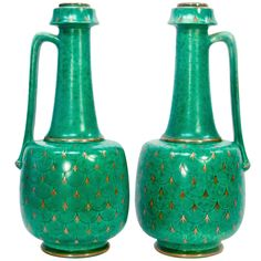 Gustavsberg Argenta Art Deco Pair of Pitchers, Sweden | From a unique collection of antique and modern pottery at https://www.1stdibs.com/furniture/more-furniture-collectibles/pottery/