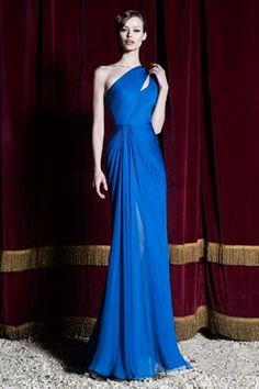 Pre F/W 2015: This is a cobalt blue one shoulder chiffon gown with  draping, a semi sheer skirt, and a thin cutout on the one shoulder. The silhouette is simple but sexy. It is Greek Goddess inspired. The cobalt blue is beautiful!