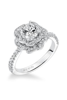Our moissanite unique engagement ring set is handmade in expert detail. This white gold floral set features a luxurious moissanite engagement ring with floral accents along either side of the band. Best Engagement Rings, Beautiful Engagement Rings, Beautiful Rings, Halo Engagement, Floral Engagement Ring, Wedding Ring Styles, Wedding Jewelry, Wedding Rings, Wedding Ideas