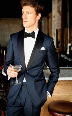 Inspired by James Bond's iconic tuxedo, it features a midnight blue twill wool with the standard tuxedo satin trimmings on the lapel, pocket besom, buttons and pant outseam. The one button dinner jacket is half canvassed with a black paisley lining, the trousers come with adjustable side tabs and suspender buttons.