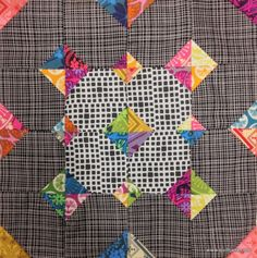 This block has a ton of room to play with fabric placement! Finished block size: 12 1/2″ x 12 1/2″ Requirements This is a scrappy block perfect for using up tiny left over squares from other projects. 1 – 10″ x 10″ square for background centre 1 – FQ for outer background 32 – 1 …