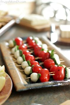 The #simplepleasures of entertaining with #CDNcheese!  Caprese Salad Bites featuring Canadian Bocconcini.