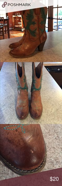 Very volatile rio grande cowgirl boots Selling a used pair of Rio Grande boots by Very Volatile. Size 8. They have a tiny scuff on top of left boot. Worn in. Approx 1-1 1/2 inch heel. Adorned with a few Swarovski crystals on sides. Beautiful teal design. Very Volatile Shoes Heeled Boots