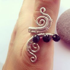 Wire work adjustable thumb ring  on Etsy, £7.50