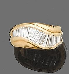 A ring, by Ventrella.  Diamonds set in gold, signed.
