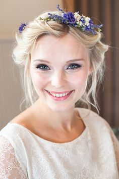 Wedding Hair. Bridal updo with a floral crown. A loose, relaxed, messy, boho style.