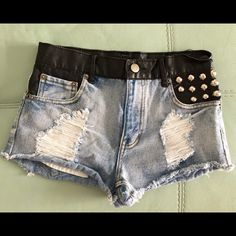 High Waisted Jean Shorts Metal decoration on pocket/black leather as seen in pic. Really cute. Worn maybe twice. Great condition, just haven't worn. From Forever 22, size XS/00/24. Forever 21 Shorts Jean Shorts