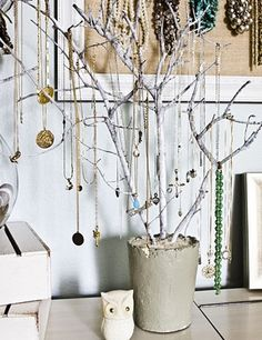 Cement a branch into a pot and use as a jewelry organizing tree