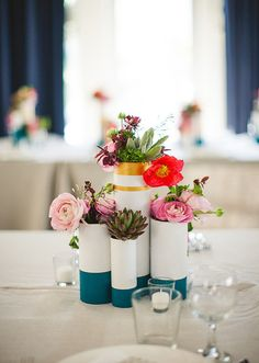 So cute! This wedding had filled vases with a mix of succulents and blooms for a playful look.  Photo by EP Love  via 100 Layer Cake
