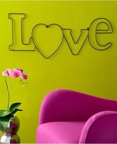 Love wall sign with lime walls and hot pink armchair = a winner.