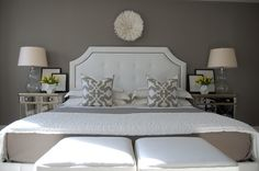White and gray bedroom features Etsy African House Pure White Juju Hat on warm gray walls over white tufted bed with brass nailhead trim Gray Bedroom, Bedroom Colors, Bedroom Wall, Master Bedroom, Bedroom Decor, Bedding Decor, Warm Grey Walls, Taupe Walls, Paint Colors For Home