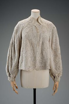 Jacket | Designed by Roy Halston Frowick, known as Halston (American, 1932-1990) | United States, 1980's | Material: silk | Cream colored jacket with scalloped collar, no front closures, and button-closure cuffs. Swirling design made of sewn-on silver beads | Museum of Fine Arts, Boston