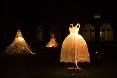 """Taegon Kim ~ """"Dresses of Memory"""" Installation at Singapore Night Festival 2014. Woven from 40 kilometres of fibre optic cables, the trio of sculptures slowly change color through the night. Image courtesy the artist via Gold and Fabulous"""