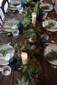 Inspired Ideas for a Dreamy Woodland Wedding a rustic table is paired beautifully with earthy elements like ferns, berries and deep blue accents.a rustic table is paired beautifully with earthy elements like ferns, berries and deep blue accents. Wedding Table Decorations, Wedding Table Settings, Decoration Table, Wedding Centerpieces, Place Settings, Centerpiece Ideas, Rustic Table Settings, Italian Table Decorations, Winter Table Centerpieces