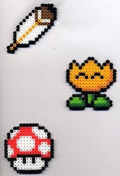 Mushroom, Feather, and Fire Flower from Super Mario World made in Perler Beads. Mario Items in Perler Beads Pixel Beads, Fuse Beads, Pearler Beads, Hama Beads Mario, Hama Beads Patterns, Beading Patterns, Pixel Art, Art Perle, Beading For Kids