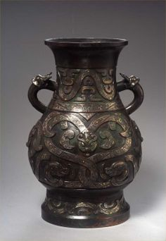 A bronze 'hu' vase inlaid with silver and gold 錯金銀雙耳銅壺 Ming dynasty, 17th century, China 明 17世紀 中國 Height: 43.5 cm, 17 inches 高43.5釐米 CIRAM thermoluminescence test no. 0508-0A-120R-1, taken from the core of this bronze, confirms the dating.