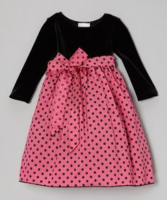 The little sweetheart is a princess in this velvety frock. A pretty bow and festive print suit the little one's fancy in stretchy, satiny-smooth comfort.