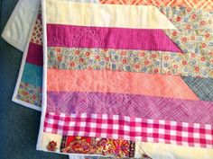 This jelly roll quilt pattern only takes about an hour to put together, and then you're free to doodle free-motion designs over the top to add some flair.