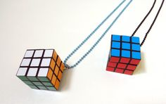 "So Cute Miniature Rubix Cube / Rubik Cube / Hungarian Cube necklace. Approx 3cm x 3cm. comes on a 24"" Aluminum ball chain necklace. available colors: silver, gold, black, red, orange-red, orange, pink, apple green, dark green, sky blue, royal dark blue, purple. $8.00 #cube #rubiks #jewelry"