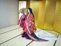 A woman dressed in junihitoe.