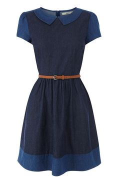 This adorable skater dress features contrasting shades of chambray denim patched together for a pretty new season look. The piece features cap sleeve styling and a peter pan collar detail. The dress is finished with a contrasting skinny waist belt and concealed zip fastening on the reverse.