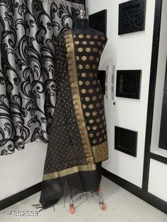 Suits & Dress Materials Nia Stylish Banarasi Polycotton Women's Suits & Dress Materials Top Fabric: Polycotton + Top Length: 2.01-2.25 Mtr Bottom Fabric: Polycotton + Bottom Length: 2.26-2.50 Mtr Dupatta Fabric: Polycotton + Dupatta Length: 2.01-2.25 Mtr Type:  Pattern: Woven Design Multipack: Single Country of Origin: India Sizes Available: Un Stitched   Catalog Rating: ★4.1 (618)  Catalog Name: Nia Stylish Banarasi Polycotton Women'S Suits & Dress Materials Vol 18 CatalogID_624714 C74-SC1002 Code: 167-4352539-7302