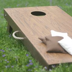 These DIY cornhole board games are the perfect way to pass a lazy afternoon. Learn how to make and build a cornhole board yourself with these easy ideas and plans. Handmade Father's Day Gifts, Diy Gifts To Make, Diy Gifts For Men, Diy Wood Projects For Men, Plywood Projects, Photo Projects, Craft Projects, Christmas Planning, Christmas On A Budget