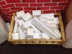 Wrapping blocks in white paper transforms them into ice blocks for building igloos.