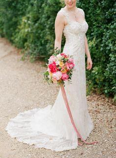 Wedding Dress: Maggie Sottero - http://www.maggiesottero.com/ Floral Design: Jardin Divers - http://www.stylemepretty.com/portfolio/jardin-divers Photography: Sophie Epton Photography - www.sophieepton.com/   Read More on SMP: http://www.stylemepretty.com/2016/07/18/an-italian-wedding-thats-not-afraid-of-color/