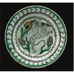 An Iznik polychrome dish with leaping jackal or dog, Turkey, 17th century | Lot | Sotheby's