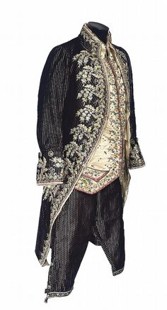 3-piece court suit, second half 18th centry. Dark blue striped velvet exquisitely embroidered with naturalistic floral motifs in coloured silks; waistcoat: cream silk satin with similar embroidered borders.