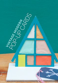 Make a collection of magnificently mod holiday pop-up cards for your friends and family!