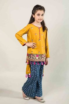Latest yellow and blue short shirt with trouser for Pakistani little girls Mariab kids party dresses 2017 for wedding Kids Party Wear Dresses, Little Girl Dresses, Girls Dresses, Pakistani Kids Dresses, Pakistani Outfits, Pakistani Kurta, Latest Dress For Girls, Kids Salwar Kameez, Kids Indian Wear