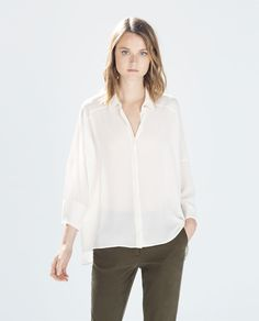 Image 1 of OVERSIZE BLOUSE WITH JEWEL BUTTON from Zara