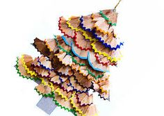 sharpened pencil shavings tree...clever...This says: arbol con ralladuras