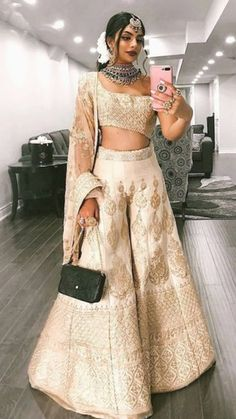 So, this stunner Ankita Malik.b never fails to amaze me with her dressing tips a. - So, this stunner Ankita Malik.b never fails to amaze me with her dressing tips and tricks. This time, she has converted her lehenga into a… Source by dahiyaaishwarya - Party Wear Indian Dresses, Indian Wedding Wear, Designer Party Wear Dresses, Indian Gowns Dresses, Indian Bridal Outfits, Dress Indian Style, Indian Designer Outfits, Pakistani Outfits, Punjabi Wedding