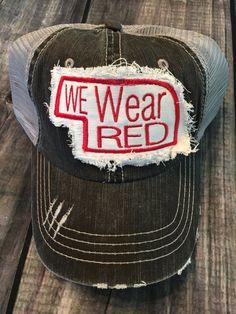 We Wear Red Nebraska Hat in White