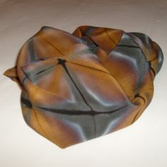 "Itajime shibori by Kim Barron: ""The scarf is just two colors, black and brown. But because I clamped it so the dye couldn't get to part of it the dye separated some giving shades to it. And the brown looks almost metallic. Steam set dye on silk"" / BaronessColor"