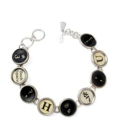 Handmade from the classic round keys of retired typewriters, this one-of-kind bracelet makes sure that you always have the write style. The nine elegant keys come from typewriters from the 1920s, 30s and 40s, and are set in sterling silver. Created by designer Ward Wallau. Handmade in the USA and Mexico. Due to the reclaimed nature of the bracelet, keys will vary.