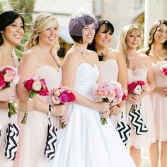 This bride incorporated black and white chevron patterns and pops of bright pink to create this effective wedding decor.