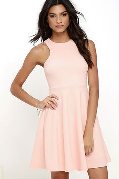 What's the perfect sweet treat to start off your week? How about the Now or Skater Peach Dress?! Poly-spandex stretch knit has a fun athletic-inspired look as it forms the sleeveless, racerback bodice complete with darted accents and a fitted waist. Hidden side seam pockets top off the darling skater skirt. Hidden back zipper.