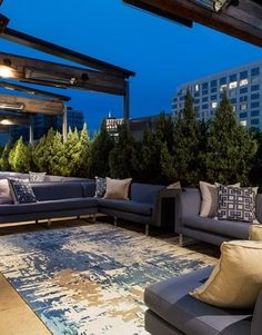 Showstopping outdoor space at W Atlanta Buckhead features a Surya Banshee rug (BAN-3342) and Gramercy pillows (LD-002).