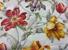 This is a beautiful floral fabric. Flowers are medium to large size and are crisply colored in golden yellows, burnt oranges, purple, red,... on a pristine white background instead of the all too frequent beige or cream, giving it a fresh blooming-spring look. The fabric looks pure cotton, thickness weight in-between medium and heavy, perfect for upholstery or drapery, a light canvas I would say because its quite a bit more pliable than standard canvas. It has a soil and stain repellent…