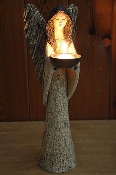 Angel candle holder. I like her face, gazing down.