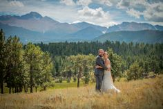 Rocky Mountain National Park Wedding Bride and Groom in Front of Trees and Mountains