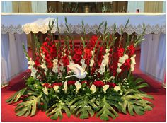 This is a 5 foot long floral arrangement for the St. Dunstan Catholic Church Confirmation of its 8th Grade students - April 21, 2016 -- Marian H.