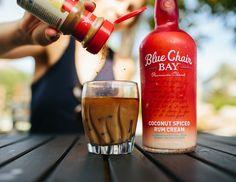 OCEANFRONT COFFEE COCKTAIL //  1 oz. Blue Chair Bay Coconut Spiced Rum Cream + 1 oz. coffee liqueur + 5 oz. cold brew coffee // Pour the cold brew and coffee liqueur over ice and stir. Shake Blue Chair Bay Coconut Spiced Rum Cream with ice and strain into prepared glass. Garnish with ground nutmeg or cinnamon on top.