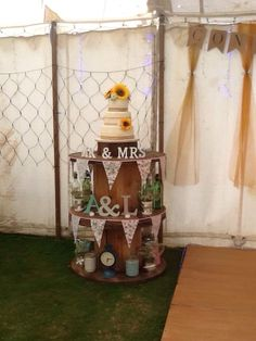 Cable reels used as a cake/display table work well for your country rustic style wedding we did this one for our wedding recently and up cycled jars and tins for lights and flowers